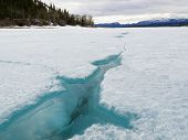 Cracked ice of frozen Lake Laberge Yukon Canada