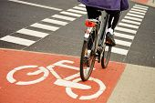 stock photo of intersection  - Bicycle road sign and bike rider on the street - JPG