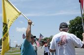 PENSACOLA, FL - 21 MAY: Protesters rally in front of local IRS office in Pensacola, FL on May 21, 20