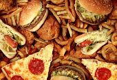 stock photo of restaurant  - Fast food concept with greasy fried restaurant take out as onion rings burger and hot dogs with fried chicken french fries and pizza as a symbol of diet temptation resulting in unhealthy nutrition - JPG