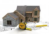 3D rendering of a rustic house on top of blueprints with a tape measure and a pencil