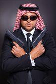 arabic secret service agent holding two handguns