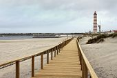 Boardwalk In Praia Barra With Lighthouse