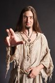 stock photo of seer  - Handsome asian man with long hair makes a gesture blessing - JPG