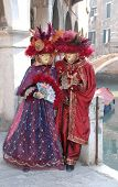 Couple In Red Carnival Costumes
