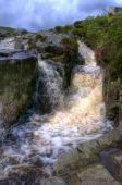 stock photo of irish moss  - A stunning waterfall in the countryside of Ireland - JPG