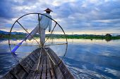 stock photo of fisherman  - Fishermen in Inle Lake at sunrise Inle Shan State Myanmar - JPG