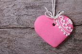 Pink Heart With A Pattern On A Background Of Wooden Board.