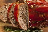 stock photo of meatloaf  - Homemade Ground Beef Meatloaf with Ketchup and Spices - JPG