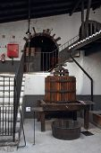 stock photo of wine-press  - Press for wine in an old and successful winery - JPG