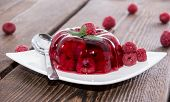 stock photo of jello  - Portion of homemade Raspberry Jello on a plate - JPG