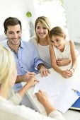 pic of family planning  - Family signing contract with home seller - JPG
