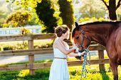 foto of saddle-horse  - a beautiful girl in a white dress and her horse - JPG