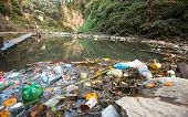 Plastic Contamination into Nature. Garbage and bottles floating on water. Environmental pollution in the Himalayas. Garbage in the water of river Bagmati.