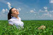 portrait of beautiful girl relaxing on field