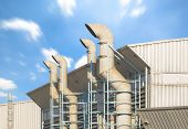 picture of ventilator  - Ventilation system of factory with blue sky background - JPG