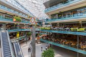 People Shopping In A Big Dutch Indoor Shopping Mall