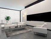 Modern living room interior in white, grey and black in minimalist style with closed blinds on the window, an illuminated standard lamp and modular contemporary lounge suite