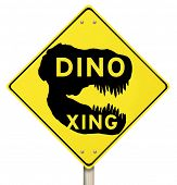 Dino Xing words on yellow warning road sign dinosaur crossing jurassic extinct creatures