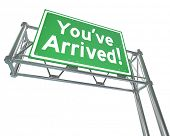 You've Arrived words on a green freeway road sign arriving your destination