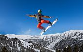Snowboarder jumping high like ninja