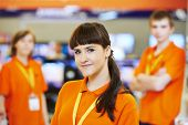 stock photo of supermarket  - Positive team of shop assistants in supermarket store - JPG