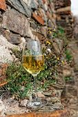stock photo of moselle  - Full glass of Riesling wine on slate rock - JPG
