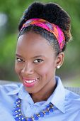 picture of jamaican  - Stock headshot of a young Jamaican woman smiling - JPG
