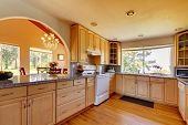 image of arch  - Beautiful kitchen interior with arch open wall to dining area - JPG