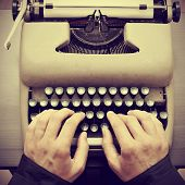 stock photo of bohemian  - man typing on an old typewriter - JPG