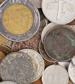 Heap of various coins and a gold.