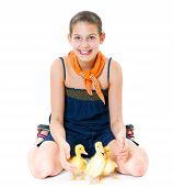 Girl with cute ducklings