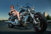 Beautiful Woman And A Motorbike