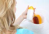 Tanning lotion - sunscreen .