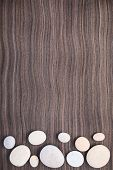 Light Stones On Wooden Ebony Tree Background