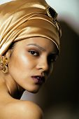 beauty african woman in shawl on head, very elegant look with gold jewelry