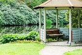 image of gazebo  - An open gazebo near a pond or lake in public park - JPG