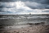 Storm over Lake Michigan, focus on seagull on the beach