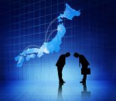 picture of cartographer  - Two business people bowing heads to each other and a japan cartograph above them - JPG