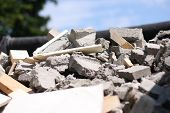 stock photo of cinder block  - Construction site after demolished garage with a pile of broken cinder blocks - JPG