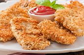 image of southern fried chicken  - Appetizing chicken nuggets breaded and fried in cereals - JPG