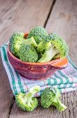 foto of cruciferous  - Broccoli Florets On The Wooden Table Close Up