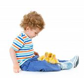 Boy with cute ducklings