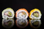 foto of dragon-fish  - Japanese seafood sushi set on black background - JPG