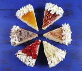 Thanksgiving Apple, Pecan, Cherry, Caramel, Pumpkin Spice And Chocolate Cream Cheesecake Pie On Dark