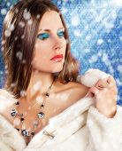 Gorgeous Woman In Fur On Vintage Background With Rays