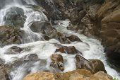 Waterfall Flows Down The Mountain