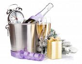 Christmas champagne with alarm clock in bucket and gift box. Isolated on white background