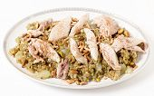 Lebanese cinnamon dusted chicken served on a bed of freekeh fire-dried green wheat with a garnish of toasted nuts. The grain, also spelt frikeh, has a low glycemic index and is high in fibre,