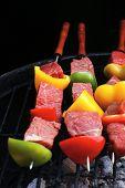 fresh raw beef shish kebab with pepper chunk on black big grill bbq high resolution hidef